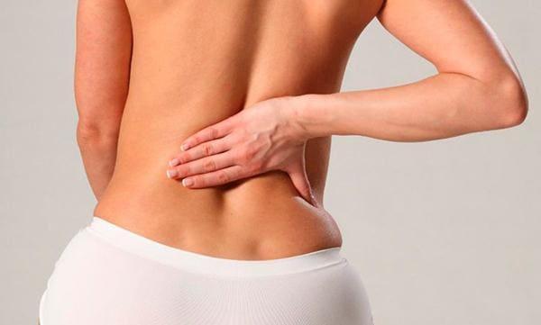 Причины тянущей боли в пояснице у женщин